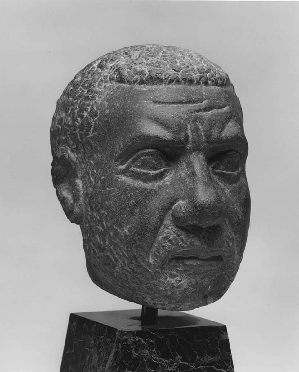 sculpture demonstrates a typical Ancient Egyptian male hairstyle